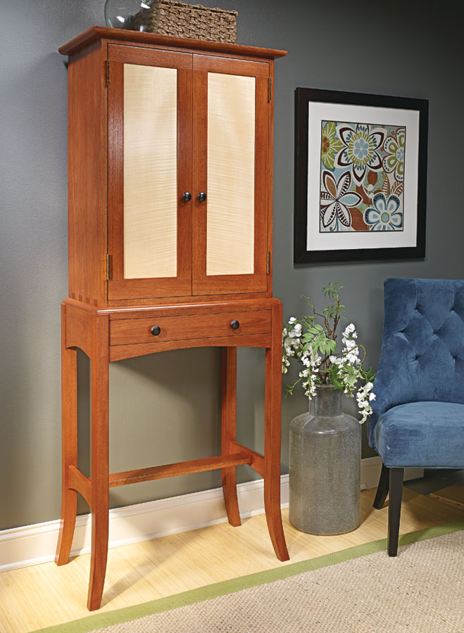 Solid mahogany, figured veneer, flared legs, and many more features make this cabinet a woodworker's dream.