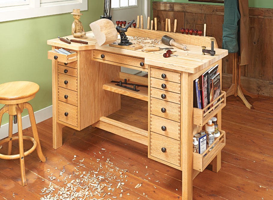 A large worksurface, plenty of storage options, and traditional looks make this bench the ideal setup for a workshop or hobby room.