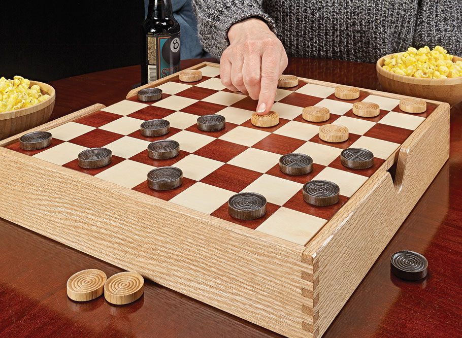 Here's a great addition to game night. This handsome board features a veneered playing surface that flips up for storage below.