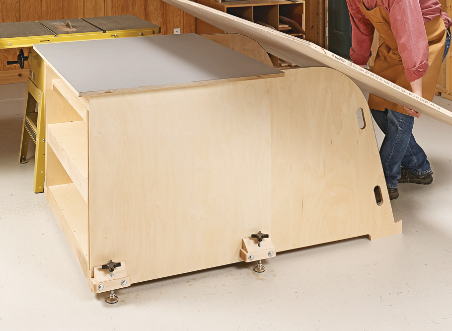 This shop upgrade has it all — a large worksurface, ample storage, and a unique sheet goods lifting system. Plus, it's mobile.