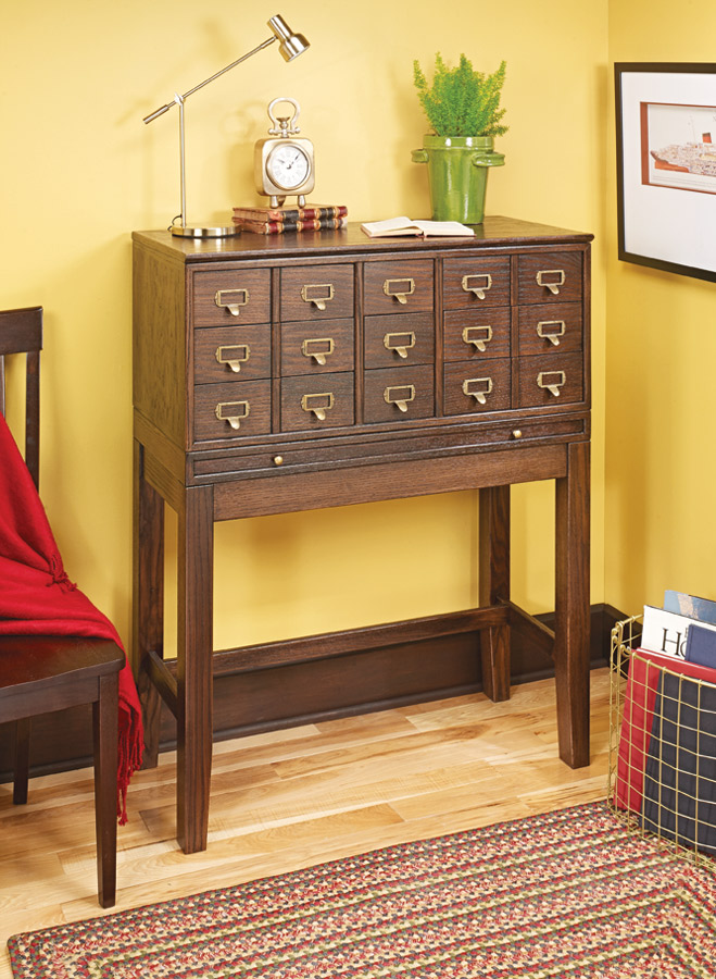 Offering up storage and a convenient writing surface, this custom cabinet is reminiscent of the old card catalogs found in libraries.