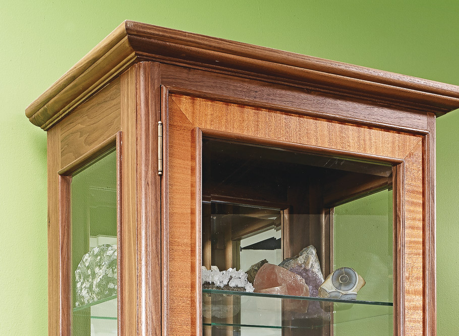 It's tough to know what to look at first, the objects stored inside this impressive cabinet or the fine woodworking it takes to build it.