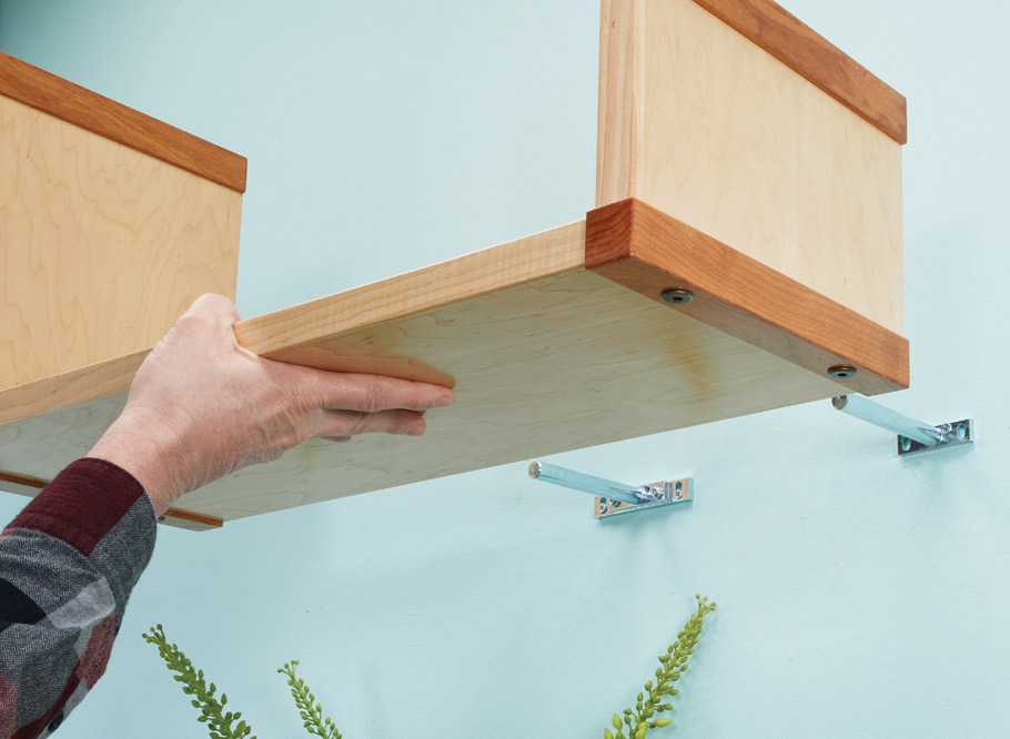 This shelf system can snake its way across your wall in any path your heart desires. Hidden fasteners anchor the shelves securely to the wall.