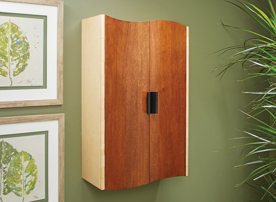 The wooden hinge and curved doors make this wall cabinet a true attention grabber. Believe it or not, building it's a straightforward process.