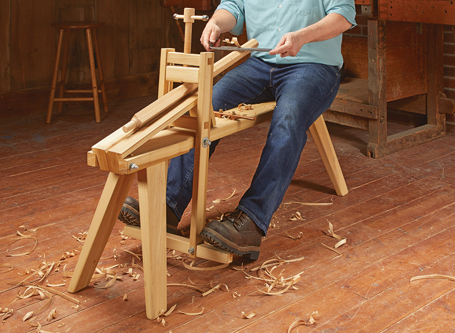 No, this isn't a woodworking rowing machine. This traditional device helps you get the most from hand tools. Our take on the traditional shavehorse features dog holes, a V-notch for sawing, and a wood screw clamp adjustment.