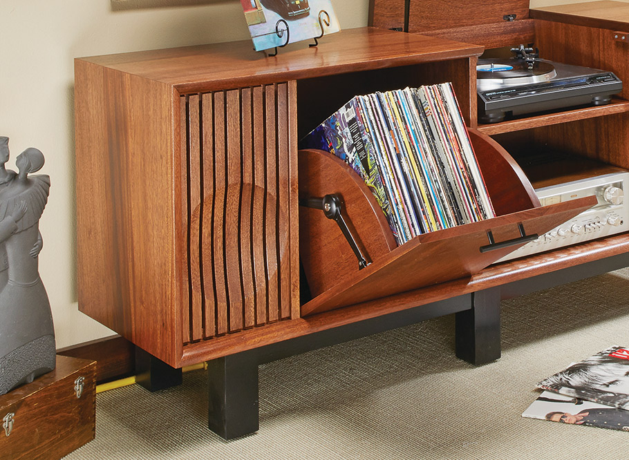 This turntable console rocks a mid-century vibe with its clean lines and low, sleek profile. Inside, there's space for components as well as your vinyl collection.