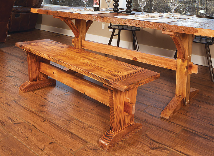 Reclaimed lumber and timber-frame design elements give this table and matching bench loads of farmhouse charm. It's sure to be a hit in any home.