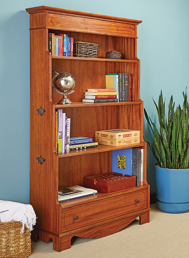 Say goodbye to boxy bookcases. This design is based on the classic Georgian style. Its graduated profile, inlay, and moldings make an eye-catching piece of furniture.