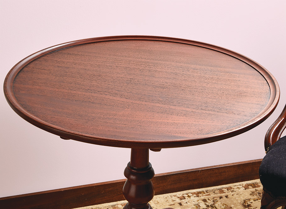 Here's a woodworking tour de force in a compact package. This beautiful table incorporates turning, carving, dovetails, and more. The result is an eye-catching showpiece.