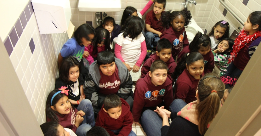 First graders huddle in the bathroom while practicing a lockdown drill in Oakland, Calif.