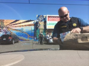Deputy from the Alameda County Sheriff's Office unloads evidence confiscated during a youth decoy sting.