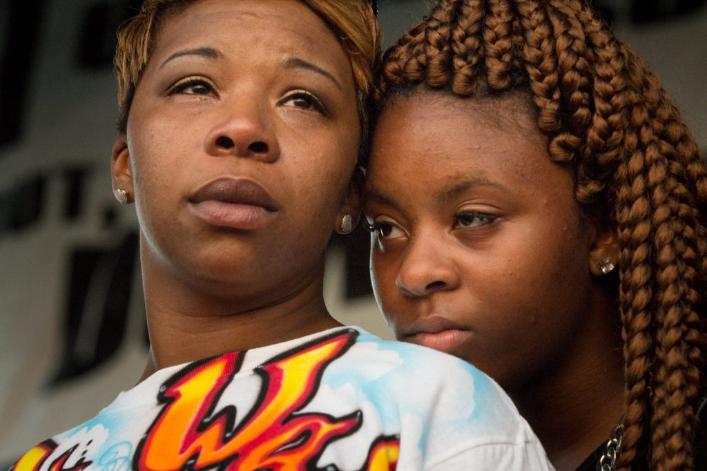 Michael Brown's mother Lesley McSpadden on stage at the St. Louis Peace Fest the day before burying her son.