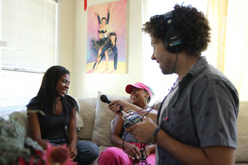 Youth Radio reporter Sayre Quevedo interviews fellow reporter Onaja Waki and her mom in their Oakland home