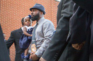 Michael Brown Sr. arriving at son's funeral