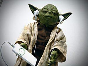 Apple earbuds on Yoda