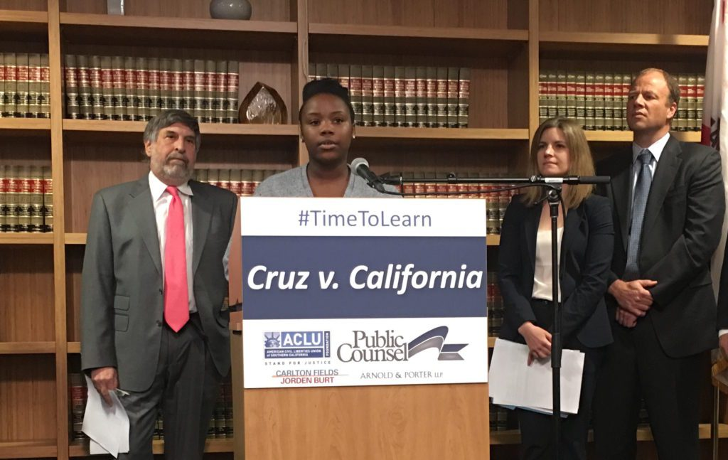 Co-plaintiff Briana Lamb stands before counsel at the 'Cruz v. California' settlement press conference. Photo: N. Nelson/Youth Radio