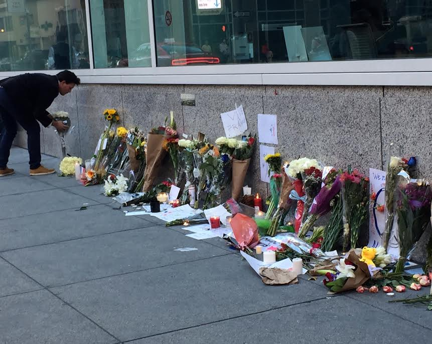 A man leaves flowers at the San Francisco French Consulate this weekend. Our thoughts are with #Paris.
