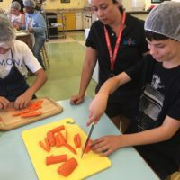 Seventh graders at Willard Middle School in Berkeley chop vegetables for their first meal of the school year. Since 2014, Willard has been partnering with start-up Josephine to sell kid-made meals to the community.