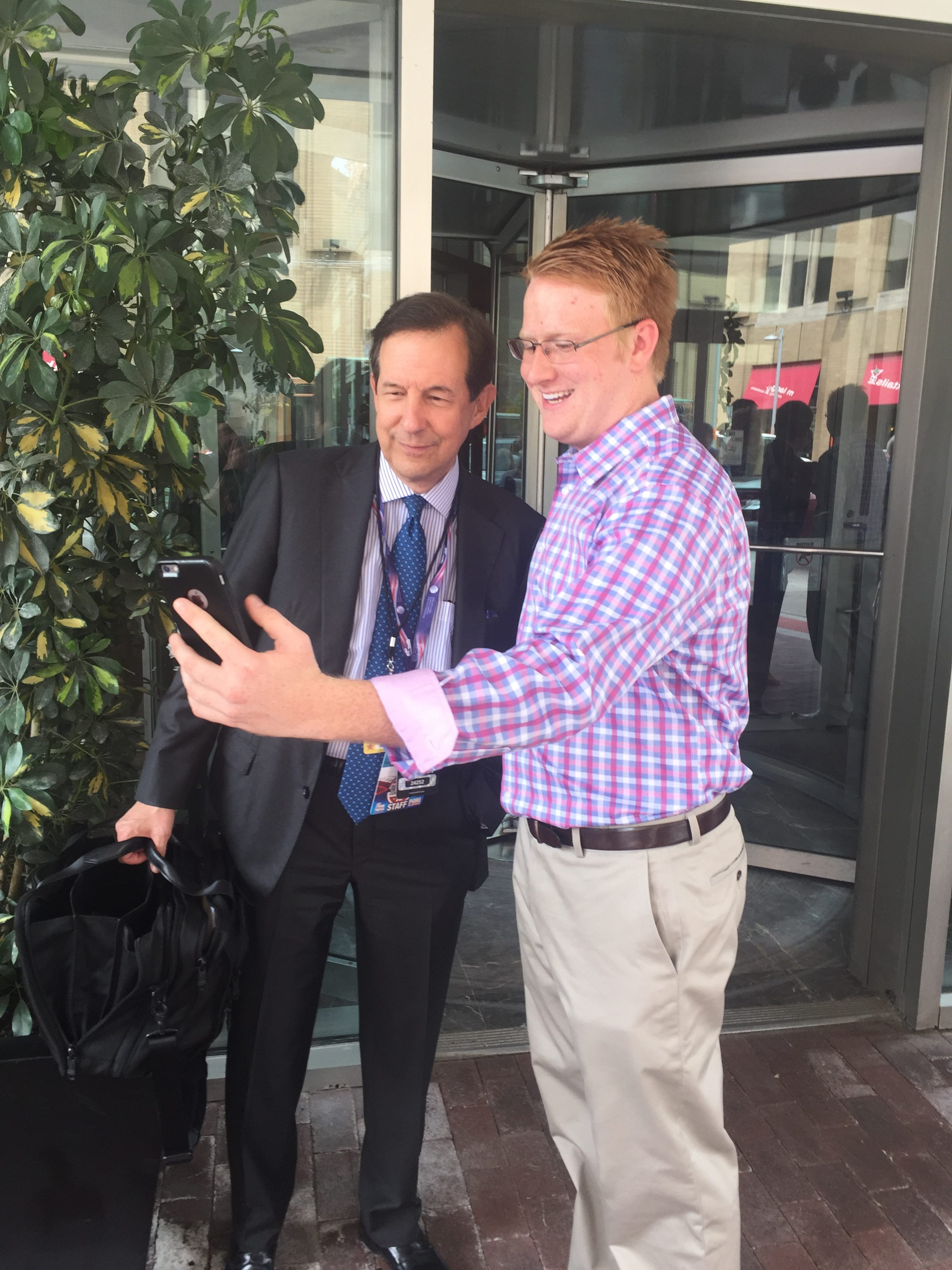 Georgia delegate Will Carter meets Fox News personality Chris Wallace at the RNC.