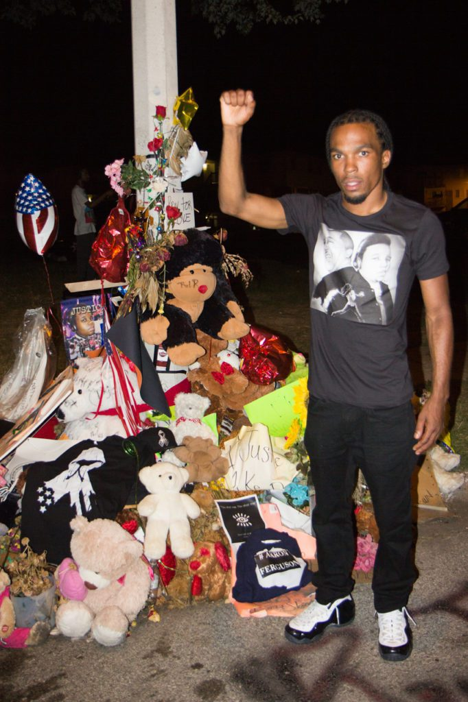 Darren Seals standing next to a memorial in August 2014 at the site where Michael Brown was shot by Ferguson Police Officer Darren Wilson. Photo: Brett Myers/Youth Radio