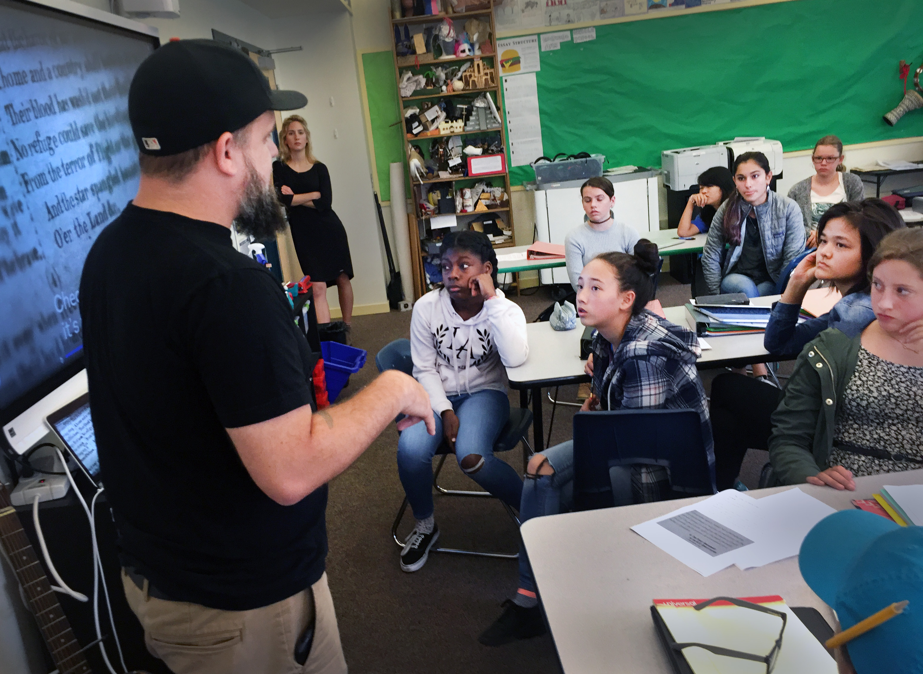 Dominic Altieri, an 8th grade history teacher at Synergy School in San Francisco, facilitates a class discussion about 49ers quarterback Colin Kaepernick's recent decision not to stand during the national anthem. Photo credit: Teresa Chin/Youth Radio