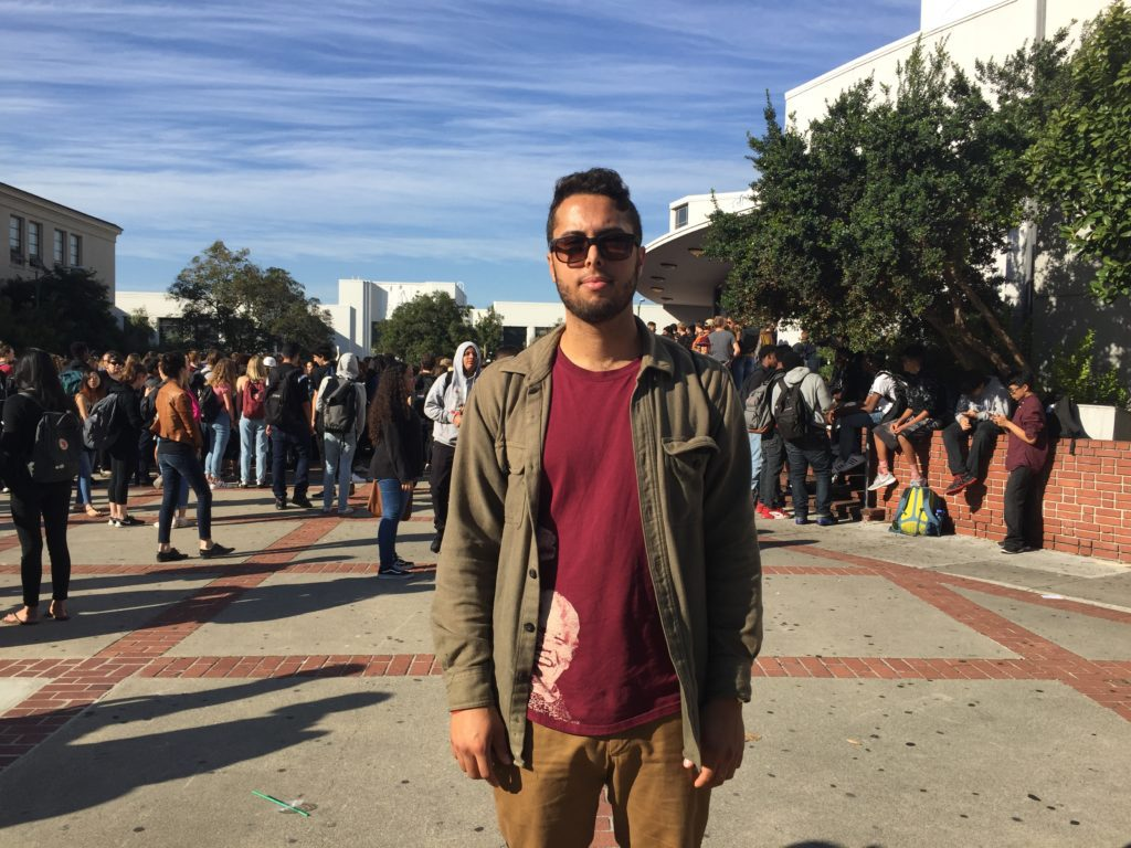 Spencer Pritchard, 23, walks among anti-Trump protesters from Berkeley High and UC Berkeley on Sproul Plaza.