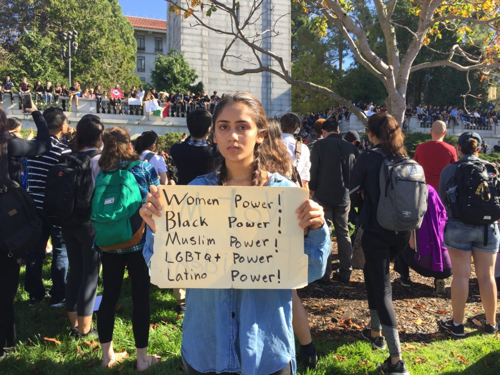 Ariana Melton, 16, holds a protest sign. On November 9, 216, students from Berkeley High in Berkeley, California, marched to UC Berkeley's Sproul Plaza in protest to the election of Donald Trump.