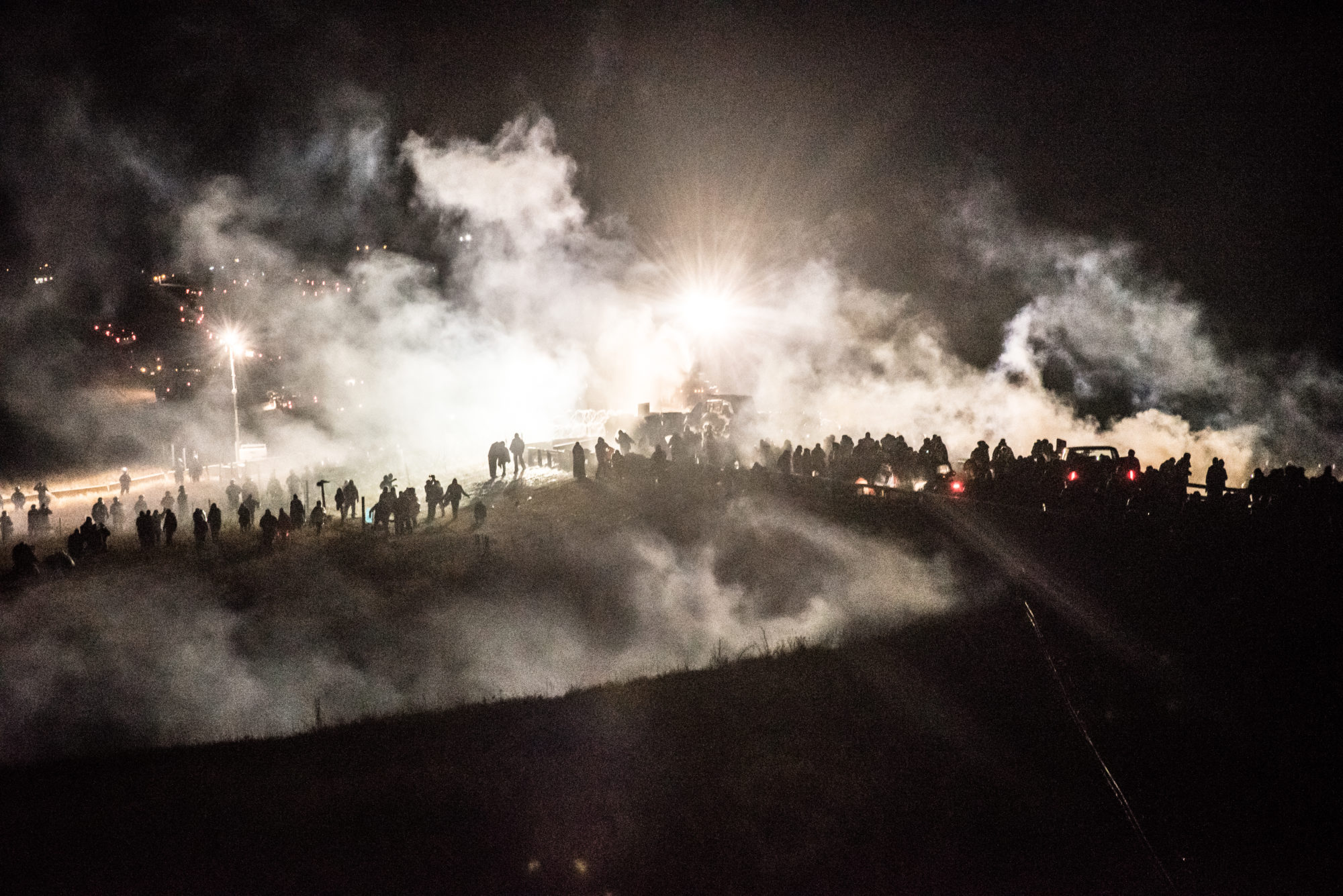 Police attack Water Defenders with tear gas, water cannons, and compression grenades. (Image: Avery White)