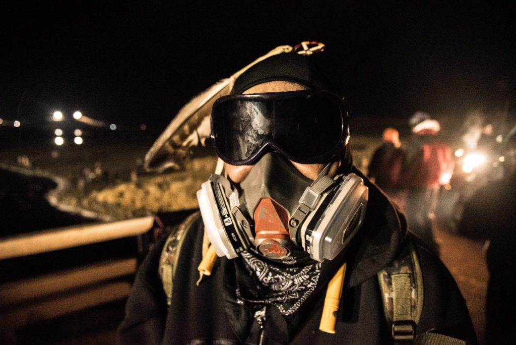 Water Defender wears gas mask to protect himself from police tear gas and pepper spray attacks. (Image: Avery White)