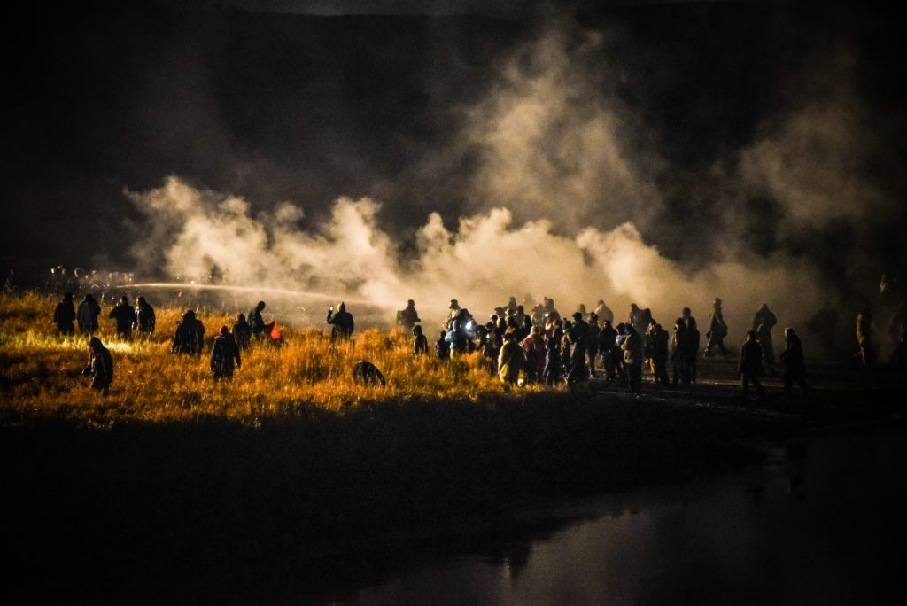 Police shoot water and tear gas into crowd. (Image: Avery White)