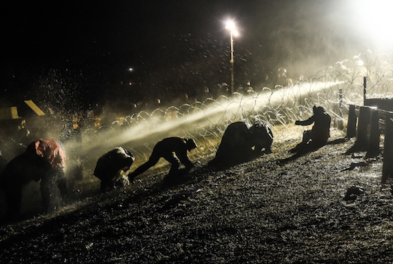 Unarmed Water Defenders were shot with water cannons while praying at frontlines. (Image: Avery White)