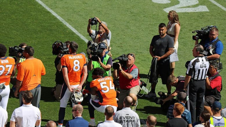 Denver Broncos linebacker Brandon Marshall taking a knee