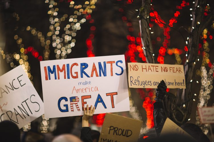 immigrants make america great sign demonstration