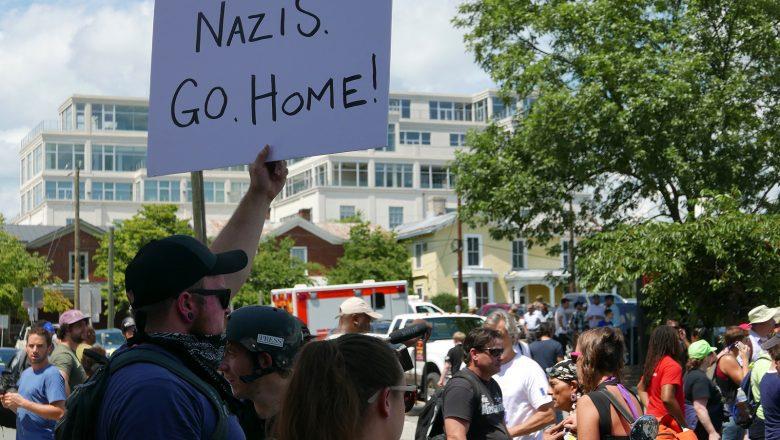 "unite the right charlottesville ""nazis go home"" sign"