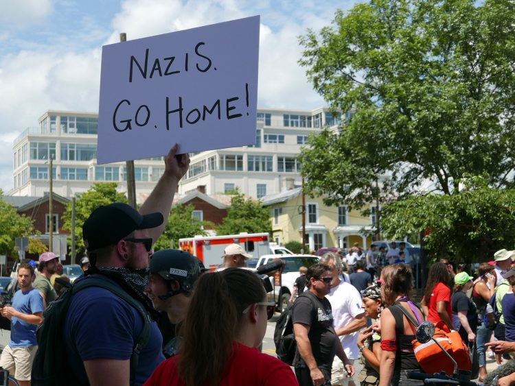 "unite the right charlottesville ""nazis go home"" sign"
