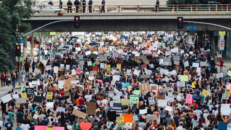 Protest crowd under a bridge.