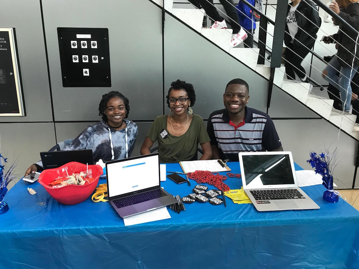Student activists Love Caesar, Kylah Guion, and Braxton Brewington are tabling in the North Carolina A&T cafeteria, ahead of the midterm elections. (Photo credit: Kamaya Truitt)