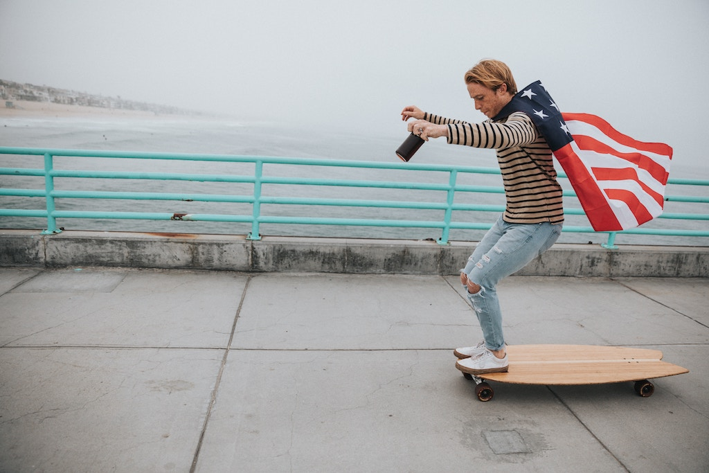 Guy on skateboard with American flag