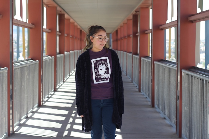 Girl standing at a bridge in El Paso.