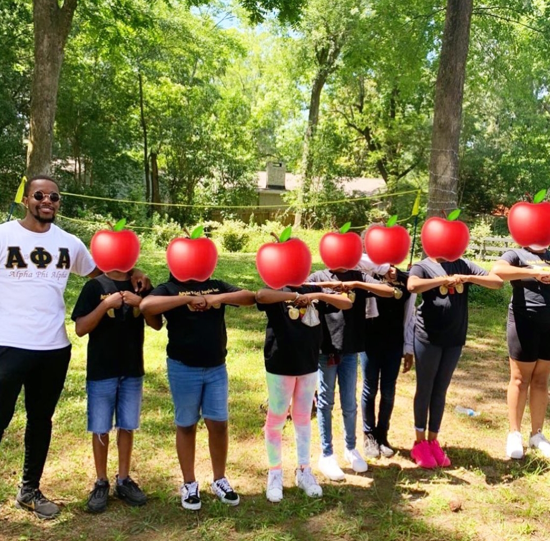 Middle School Students Initiated into 'Apple' Organization