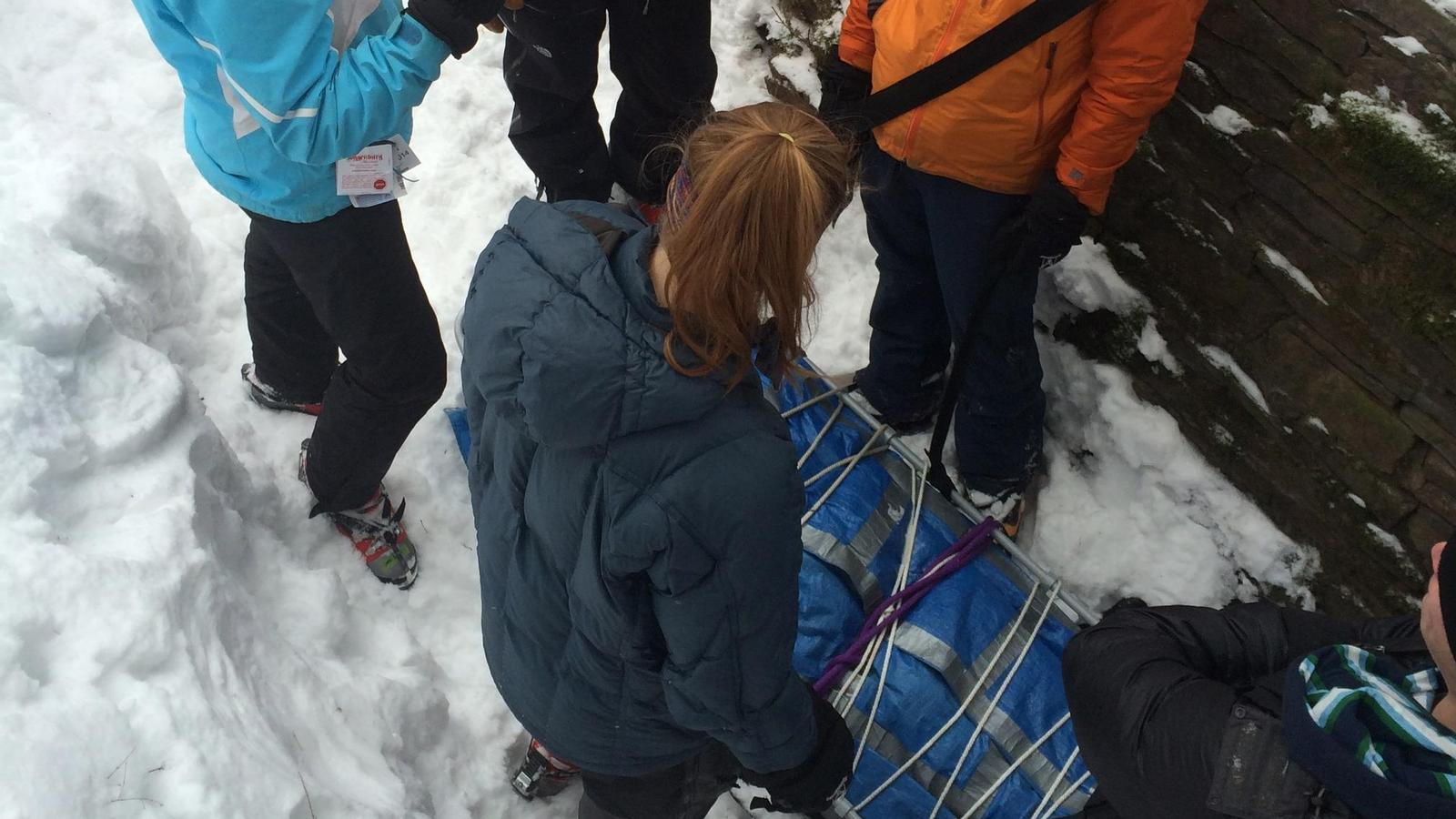 Students practice winter rescue.