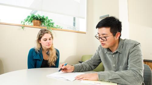 Bryce Fan tutoring in Writing Center