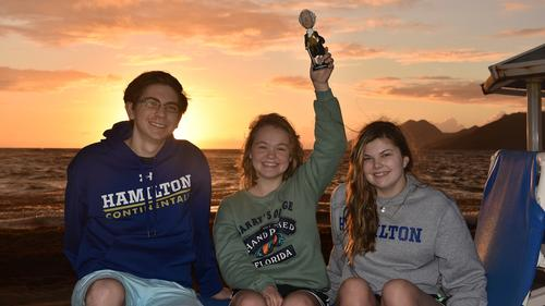 L-R Skylar Havens, Kayley Boddy and Sam Wilkerson with Alex on Nevis