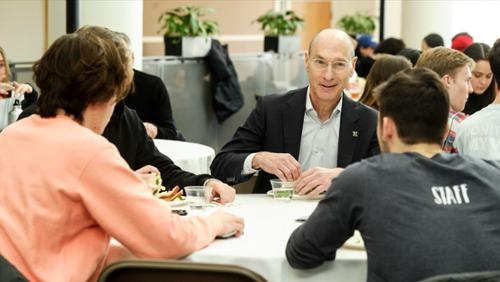 President Wippman eating lunch with students