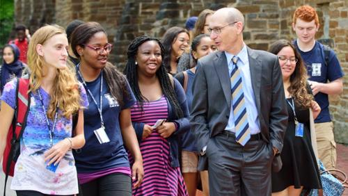 President Wippman walking with students