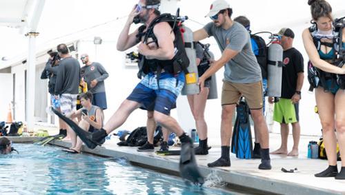 Preston Perez '22 guides diver into pool