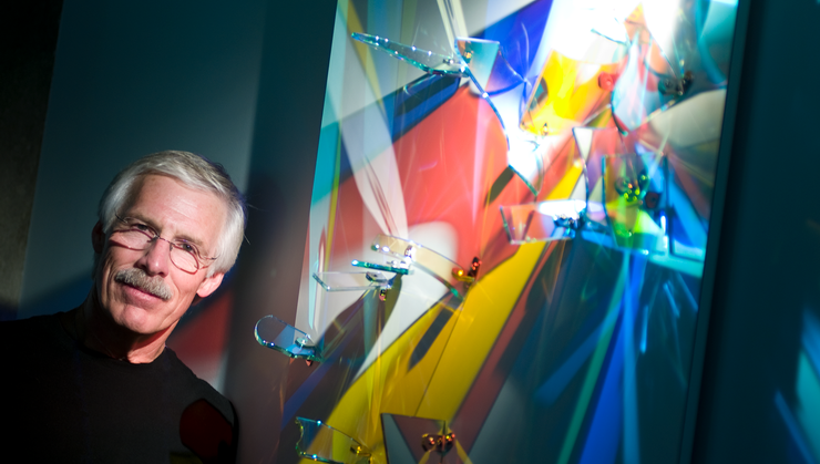 Stephen Knapp '69 stands next to the lightpainting he created for Hamilton College.
