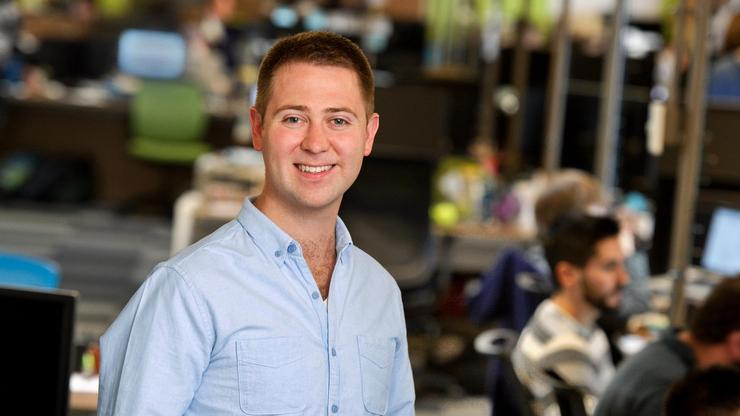 """""""Serial entrepreneur""""Mark Kasdorf '06, shown here at the Intrepid headquarters, has launched four companies since he graduated from Hamilton"""