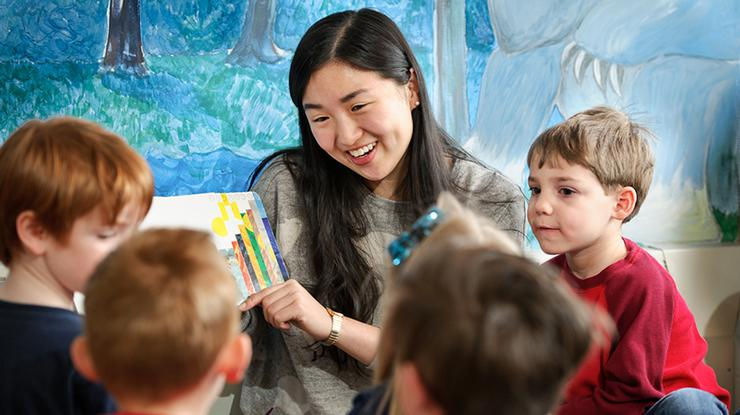 Kim Wang '14 in her Hamilton days, volunteering at the Clinton Early Learning Center.
