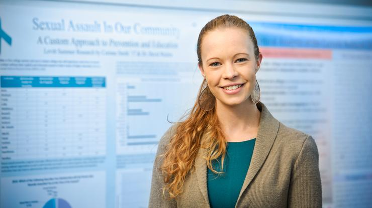 Corinne Smith '17 presents her research during a poster session on campus.